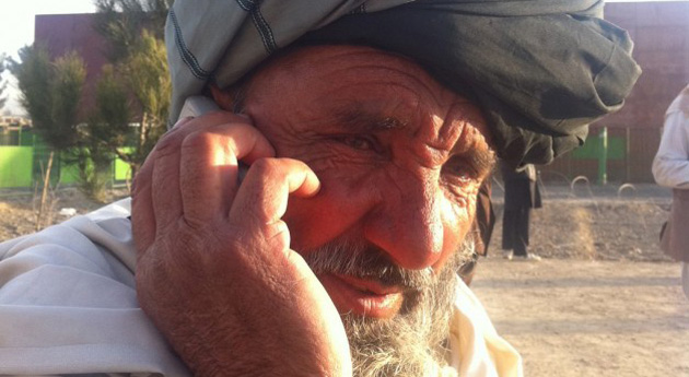 Afghan man on mobile phone